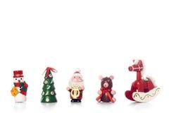 Christmas ornaments. Hand made in wood. teddy bear, tree, santa claus, rocking horse Stock Photos