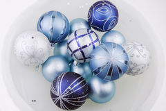 Christmas Ornaments. Festive Christmas ornaments arranged in a glass bowl Royalty Free Stock Image