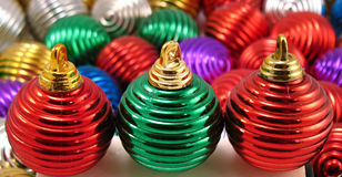 Christmas ornaments. Assorted christmas ornaments different colors same shapes Royalty Free Stock Photography
