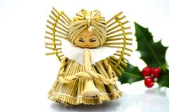 Christmas ornaments - angel christmas tree ornament and green holly royalty free stock photography