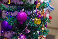 Christmas ornaments. On an artificial tree Royalty Free Stock Photos