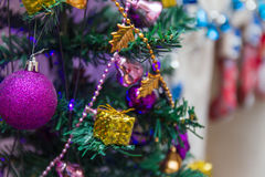 Christmas ornaments. On an artificial tree Royalty Free Stock Photography