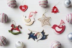 Christmas Ornaments on background. Christmas collection, decorative ornaments, on wood background Royalty Free Stock Image