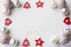 Christmas Ornaments on background. Christmas composition on white wooden background with copy space Stock Image