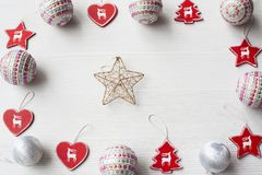Christmas Ornaments on background. Christmas composition on white wooden background with copy space Royalty Free Stock Image