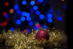 Christmas ornaments. Christmas ball ornament with gold garland on bokeh background Royalty Free Stock Photo