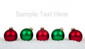 Christmas ornaments/baubles on white Stock Image