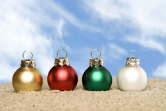 Christmas ornaments on the beach Stock Photography