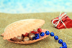 Christmas ornaments on the beach Royalty Free Stock Photo