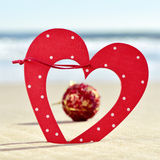 Christmas ornaments on the beach Stock Images