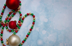 Christmas ornaments and beaded garland Stock Images