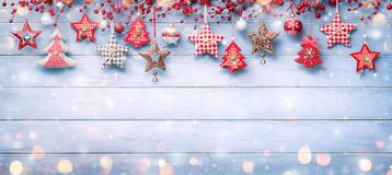 Christmas Ornaments And Berries Hanging Royalty Free Stock Photography