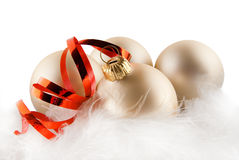 Christmas ornaments in billowy feathers. High key effect isolated on white Royalty Free Stock Photography