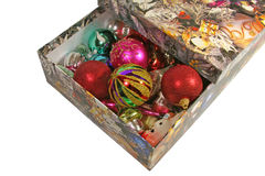 Christmas ornaments in a box. Christmas ornaments in a box over white background Stock Photos
