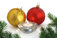 Christmas ornaments and candle. Christmas ornaments with candle and some pine branches Stock Images