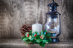 Christmas ornaments and candle light on rustic wood.  Stock Photography