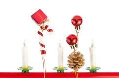 Christmas ornaments and candles Stock Photography
