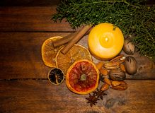 Christmas decoration with candle and dried fruits on wooden background Royalty Free Stock Images