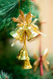 Christmas ornaments on Christmas tree. Golden bells decorations on Christmas tree. new year Stock Image