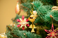 Christmas ornaments on Christmas tree. Golden bells decorations on Christmas tree. new year Royalty Free Stock Photos