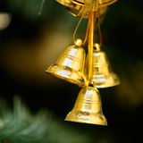 Christmas ornaments on Christmas tree. Golden bells decorations on Christmas tree. new year Stock Photography