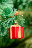 Christmas ornaments on Christmas tree. Red box gift toy decorations on Christmas tree. new year Royalty Free Stock Images