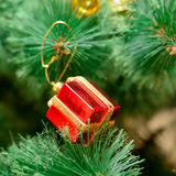 Christmas ornaments on Christmas tree. Red box gift toy decorations on Christmas tree. new year Stock Photo