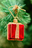 Christmas ornaments on Christmas tree. Red box gift toy decorations on Christmas tree. new year Stock Image