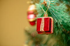 Christmas ornaments on Christmas tree. Red box gift toy decorations on Christmas tree. new year Stock Photos