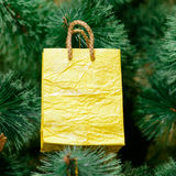 Christmas ornaments on Christmas tree. Yellow gift package decorations on Christmas tree. new year Royalty Free Stock Photo