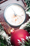 Christmas ornaments and clock Stock Photos