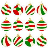 Christmas Ornaments. A collection of 12 multicolored Christmas ornaments in red, green & yellow. Isolated on white Stock Photography