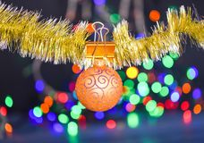 Christmas ornaments concept. Ball ornament hang on shimmering tinsel. Pick colorful decor for christmas tree. Tinsel. With pinned christmas ornament on royalty free stock image