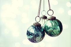 Christmas ornaments with copy space to side. Blue and green Christmas ornaments with copy space to side royalty free stock photo