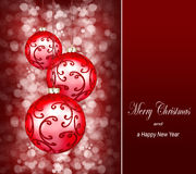 Christmas ornaments on a dark red background Stock Photo