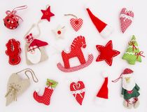 Christmas ornaments decoration Red textile toys. Christmas ornaments and decorations on white background. Red textile toys Stock Images