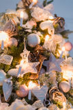 Christmas ornaments are decorations usually made of glass, metal, wood or ceramics that used to festoon a tree. Blurred gifts on stock image