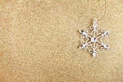 Christmas Ornaments on Elegant Gold Christmas background. Festiv Royalty Free Stock Photography