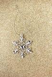 Christmas Ornaments on Elegant Gold Christmas background. Festiv Royalty Free Stock Images