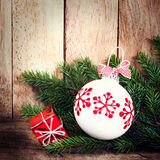 Christmas Ornaments with fir tree branch over wood wall. Vintage Royalty Free Stock Photo