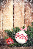 Christmas Ornaments with fir tree branch over wood wall. Vintage Royalty Free Stock Image