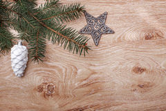 Christmas ornaments and fir tree branch on a rustic wooden background. Xmas card. Happy New Year. Top view Stock Photos