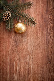 Christmas ornaments and fir tree branch on a rustic wooden background. Xmas card. Happy New Year. Top view Royalty Free Stock Image