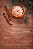 Christmas ornaments, food decor and fir tree branch on a rustic wooden background. Xmas card. Happy New Year. Top view Royalty Free Stock Photo