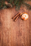 Christmas ornaments, food decor and fir tree branch on a rustic wooden background. Xmas card. Happy New Year. Top view Stock Photo