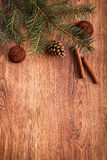Christmas ornaments, food decor and fir tree branch on a rustic wooden background. Xmas card. Happy New Year Stock Photography