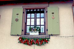 Christmas ornaments in front of a house in a small village Alsace. A charming little village decorated for Christmas in Alsace, France Stock Photography