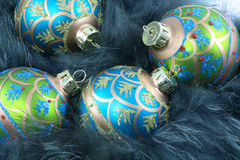 Christmas Ornaments and Fur. Turquoise and green Christmas ornaments nestled in turquoise fur Stock Photo