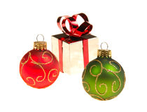 Christmas ornaments gift box blur. Christmas tree ornaments isolated on white background shiny gift box in distance slight blur intentional Royalty Free Stock Photography