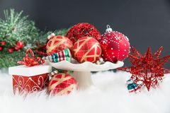 Free Christmas Ornaments, Gifts, And Evergreens On Fur Stock Image - 131597531